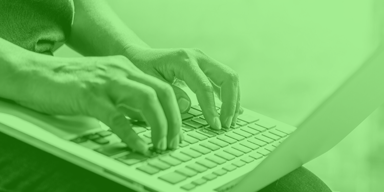 two hands typing on a computer with a green overlay online student registrations